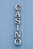 Casino Sign 1. A vertical unlit neon Casino sign on a rough textured wall Stock Photography