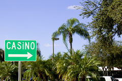 Casino Sign. Casino direction sign with a tropical blue sky background Royalty Free Stock Photos