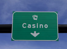 Casino sign. Road sign indicating the direction of the casino stock photography