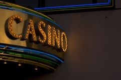 Casino sign. Dirty neon casino sign at night Stock Images