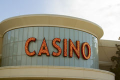 Casino sign in lights. On building in daylight Stock Photo