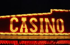 Casino sign over fairground arcade. Royalty Free Stock Images
