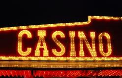 Casino sign over fairground arcade. Illuminated Casino sign over fairground arcade of gaming machines. Sussex. England Royalty Free Stock Images