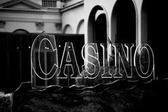 Casino sign. A transparent Casino sign made of glass on a rock decoration Royalty Free Stock Photo
