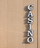 Casino Sign. White casino sign on exterior wall during a sunny day Stock Photo