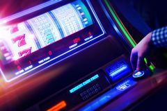 Casino Slot Machine Player royalty free stock photos