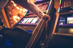Casino Slot Machine Player. Woman Playing One Handed Bandits stock photography