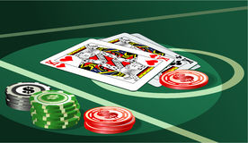 Casino table with chips and cards Stock Image