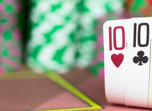 Casino Texas Hold`em Poker game. Two cards on the table Stock Image
