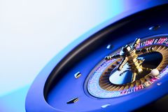 Casino theme. Place for typography. High contrast image of casino roulette. Blue background. Place for text stock images