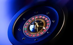 Casino theme. Place for typography. High contrast image of casino roulette. Blue background. Place for text royalty free stock images
