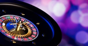 Casino theme. Place for typography. High contrast image of casino roulette. Blue bokeh background. Place for text royalty free stock photo