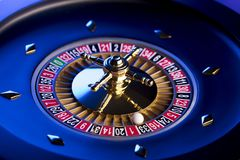 Casino theme. Place for typography. High contrast image of casino roulette. Blue background. Place for text stock photo