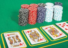 Casino tokens and cards showing a royal flush Royalty Free Stock Photo