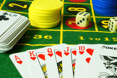 Casino variant 5. Casino still life. Dice, numbers, cards, chips close-up Royalty Free Stock Photo