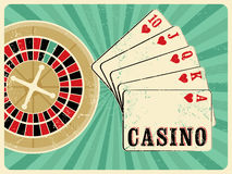 Casino vintage grunge style poster with playing cards and roulette. Retro vector illustration. Stock Photography