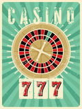 Casino vintage grunge style poster with roulette. Retro vector illustration. Stock Photography