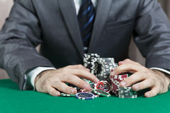 Casino winner. Man hands holds casino chips Royalty Free Stock Image