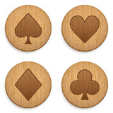 Casino wooden round icon card suits Stock Photography