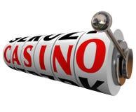 Casino Word Slot Machine Wheels Gambling Betting. The word Casino on slot machine wheels to symbolize a fun gambling destination such as Las Vegas or other Stock Photography