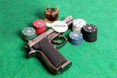 Casino y arma fotos de archivo