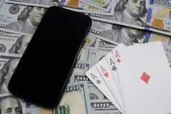 Casinos virtuales, dinero real foto de archivo libre de regalías