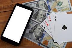 Casinos virtuales, dinero real fotos de archivo libres de regalías