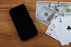 Casinos virtuales, dinero real fotos de archivo