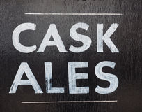 Cask ales sign. Outside a British pub serving real ale Royalty Free Stock Image