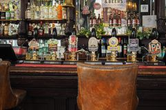 Cask beers in London. LONDON, UK - SEPTEMBER 28, 2015: Draught cask beers in a traditional English Pub stock photo