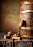 Cask and corkscrew. Wooden cask with corks and corkscrew on a table Royalty Free Stock Images