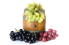 Cask with red, black and white grapes Stock Photo