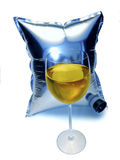 Cask Wine. Glass of white wine and the bladder from a cask of wine stock image