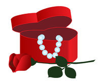 Casket. In a heart-shaped jewels and roses Royalty Free Stock Photography