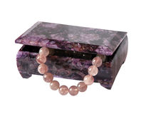 Casket from charoit with a beads from quartz Royalty Free Stock Photo