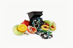 Casket and fruit. Composition from different fruit and ornaments in a casket Stock Image