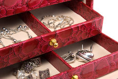 Casket with jewelry. The red casket with jewelry is photographed a close-up Royalty Free Stock Photo