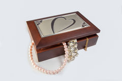 Casket with jewelry. Wooden casket with jewelry of gold and pearls Royalty Free Stock Image