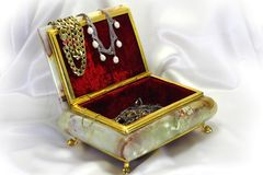 Casket from onyx in a gold frame Stock Images