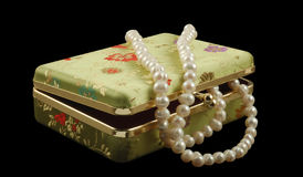 Casket with pearls. Isolated on black Royalty Free Stock Photos