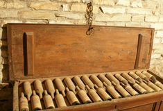 Casket of Vintage Wine. Pine box filled with vintage dusty wine against a brick wall Stock Photography