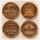 Casks with alcohol drinks. Set of wooden barrels with alcohol drinks emblems. Vector illustration Stock Images