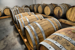 Casks in wine cellar Stock Images