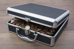 Caso con las monedas Foto de archivo libre de regalías