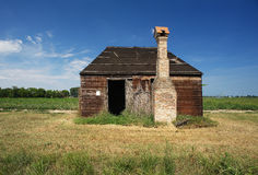 Casoni. Codigoro (Fe),Emilia Romagna,Italy, traditional old buildings of wood and straw for farm on the edge of a field of tomatoes Stock Images
