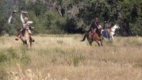 CASPER, WY__CIRCA JULIO 2015__Soldiers y reconstrucción de los indios en Casper, Wy circa julio de 2015 Imagen de archivo libre de regalías