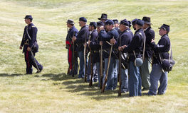 CASPER, WY__CIRCA  JULY  2015__Soldiers and indians reenactment in Casper, Wy. circa July 2015. Old time soldiers at the Ft. Caspar Days reenactment near Royalty Free Stock Photo