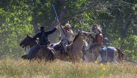 CASPER, WY__CIRCA  JULY  2015__Soldiers and indians reenactment in Casper, Wy. circa July 2015. Old time Indians at the Ft. Caspar Days reenactment near Casper Royalty Free Stock Image