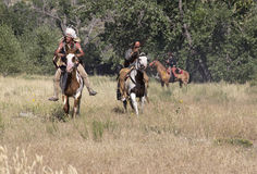 CASPER, WY__CIRCA  JULY  2015__Soldiers and indians reenactment in Casper, Wy. circa July 2015. Old time Indian re-enactors at Ft. Caspar Days near Casper Stock Image