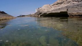 Caspian sea above and under water. Caspian sea off the rocky coast of the city of Aktau. Kazakhstan. Under and above water stock footage